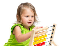 Kid playing with abacus. Kid girl playing with abacus stock images