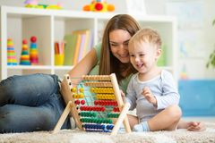 Kid playing with abacus royalty free stock images