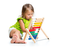 Kid playing with abacus. Toddler baby playing with abacus stock photos