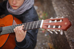 Kid playing acoustic guitar close-up. Stock Photography