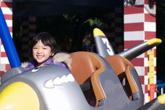 Kid playing in the amusement park Stock Image