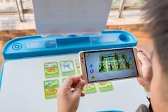 Kid playing Augmented Reality popup of the dinosaurs via mobile stock photos