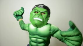 Kid playing with Avengers incredible hulk dress stock video footage