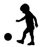 Kid playing with ball Stock Images