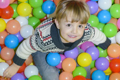 Kid Playing with Balls Royalty Free Stock Photography