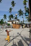 A kid playing basket ball Stock Images