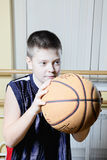 Kid playing basketball Royalty Free Stock Images
