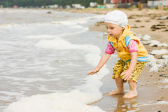 Kid playing on the beach Stock Photography