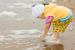 Kid playing on the beach Stock Images