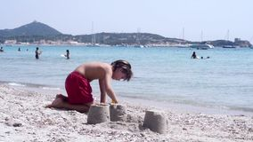 Kid playing on the beach stock video footage