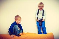 Kid playing with big professional digital camera Stock Photo