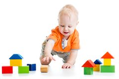 Kid playing with block toys Stock Images