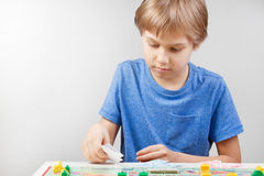 Kid playing board game Royalty Free Stock Photo