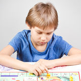 Kid playing board game Stock Image