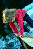 Kid playing on a boat Stock Photography