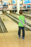Kid playing bowling Stock Images