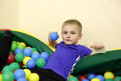 Kid playing in box of balls Royalty Free Stock Photo