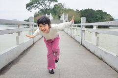 Kid playing on the bridge Royalty Free Stock Photo
