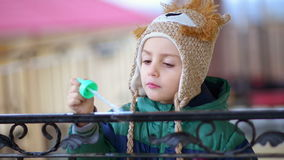 Kid Playing with Bubble Blower stock video footage