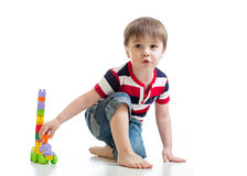 Kid playing with building blocks Stock Image