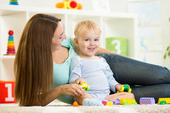 Kid playing with building blocks at kindergarten Royalty Free Stock Images
