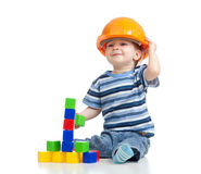 Kid playing with building blocks toy Stock Images