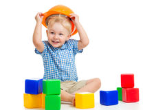 Kid playing with building blocks toy. Kid boy playing with building blocks toy stock image