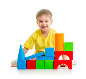 Kid playing with building blocks Stock Photo