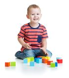 Kid playing and building tower with colorful Stock Image