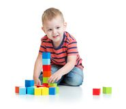 Kid playing and building tower with colorful Royalty Free Stock Photography