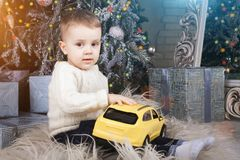 Kid playing with car toy stock photography