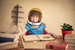 Kid playing with cardboard toy rocket Royalty Free Stock Images