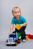 Kid playing with cars Royalty Free Stock Photo