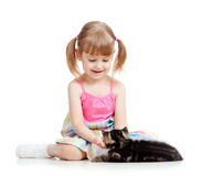 Kid playing with cat Stock Photography