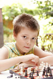 Kid playing chess Royalty Free Stock Image