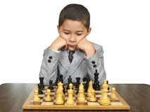 Kid playing chess Stock Photos