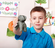 Kid playing with clay. Stock Images