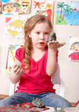 Kid playing with clay. Stock Image