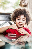 Kid playing with clay. Little boy playing with clay at home Stock Photography