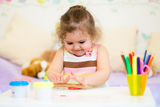 Kid playing with colorful clay toy Stock Image