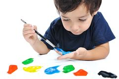 Kid playing with colors Royalty Free Stock Photos