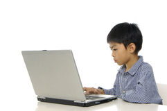 Kid playing computer Royalty Free Stock Photo