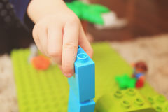 Kid playing with constructor Royalty Free Stock Photo