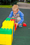 Kid playing with cubes Stock Photography