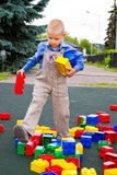 Kid playing with cubes Stock Image
