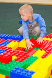 Kid playing with cubes Royalty Free Stock Images