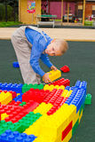 Kid playing with cubes Royalty Free Stock Image