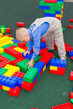 Kid playing with cubes Royalty Free Stock Photography