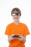 Kid playing 3D game with control Royalty Free Stock Images