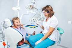 Kid playing with dental drill Stock Photos